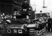 1939 - Clifford has to leave to fight in the Second World War (front of tank).